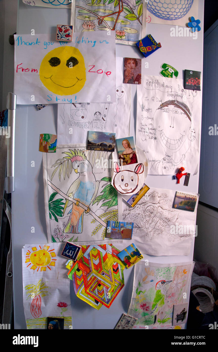 Childrens\u0027 drawings held in place by magnets on fridge door & Childrens\u0027 drawings held in place by magnets on fridge door Stock ... Pezcame.Com