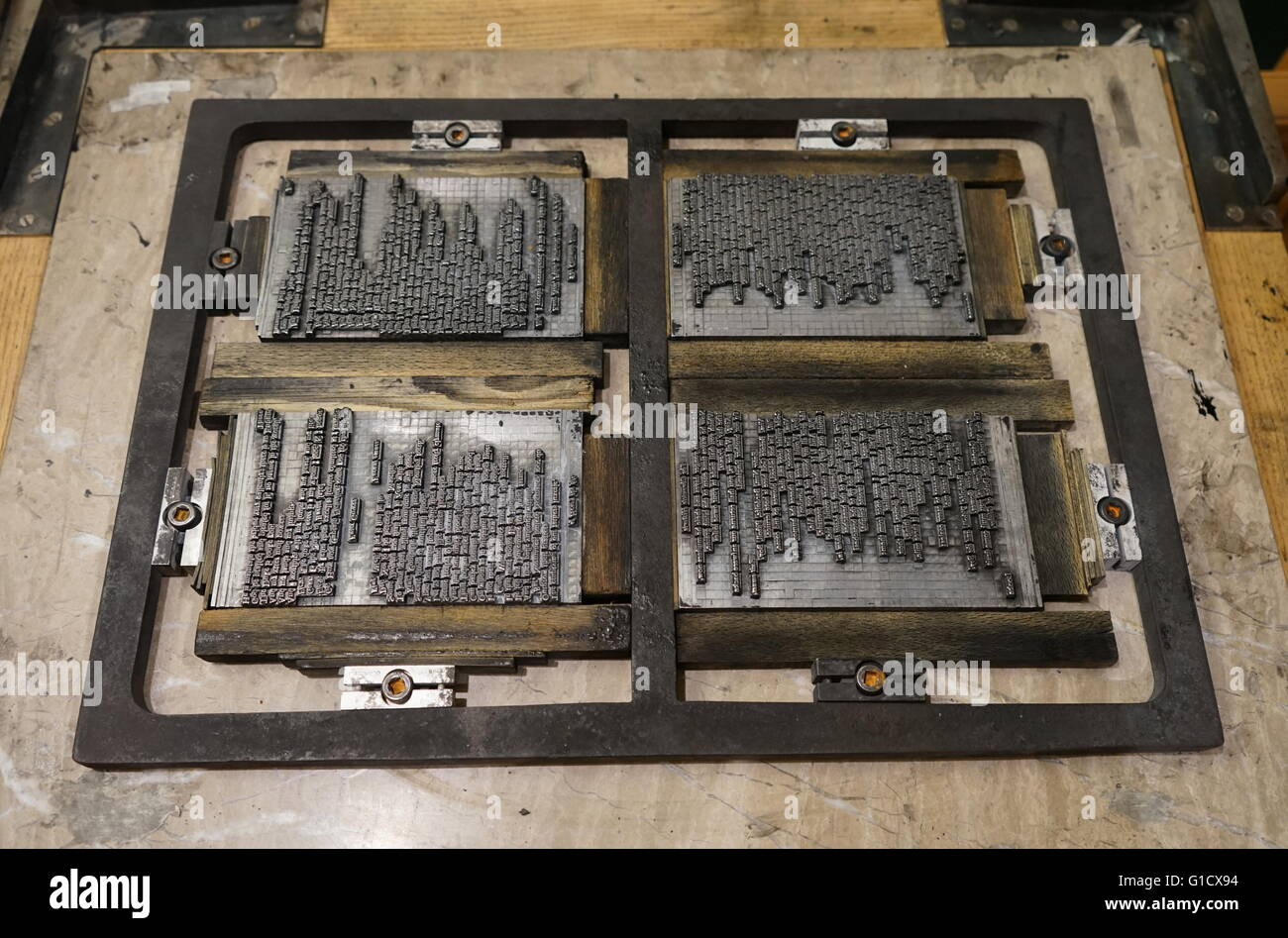 metal plate with letters set to print a page from a reconstruction of a 16th century printing press