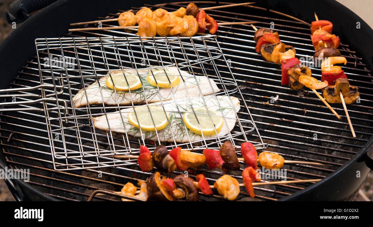 Summer bbq fish and vegetables being cooked on a grill for Bbq fish grill