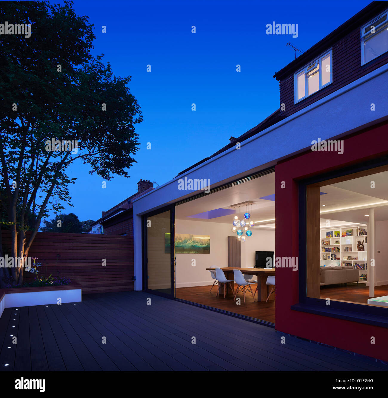 Single Storey Extension Mincheon Road London View Of A Modern Patio With Open Glass Sliding Doors Leading Into Plan Living Area Dining Table