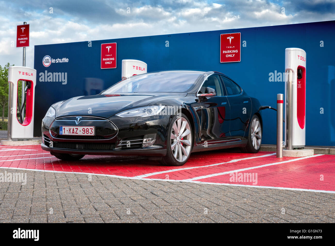 Tesla Electric Car On A Charging Station At Euro Tunnel Terminal