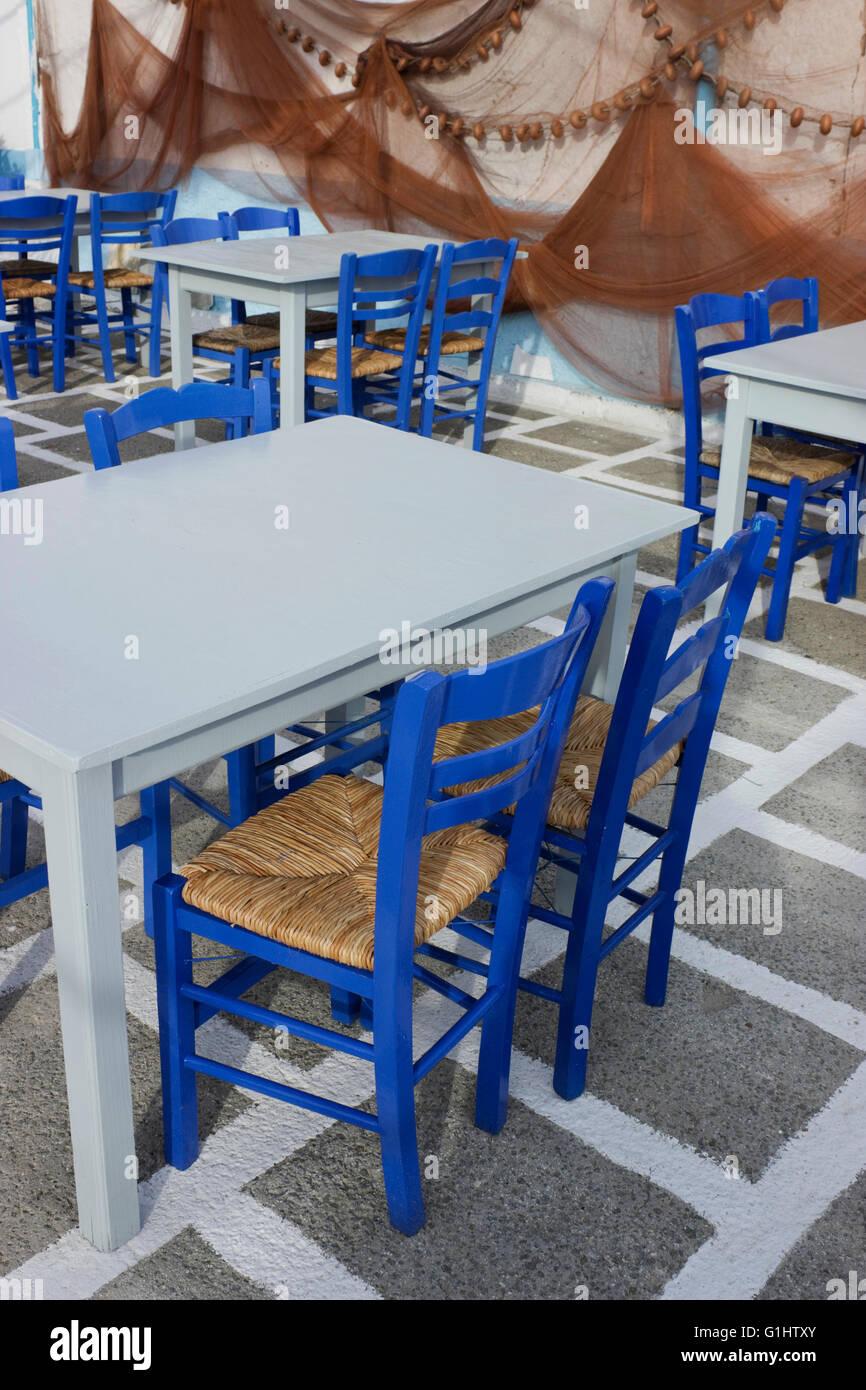 Blue Chairs, Cyan Empty Fish Tavern Tables On Chequered Whitewash Floor U0026  Fishing Nets Decoration Background.Myrina, Lemnos