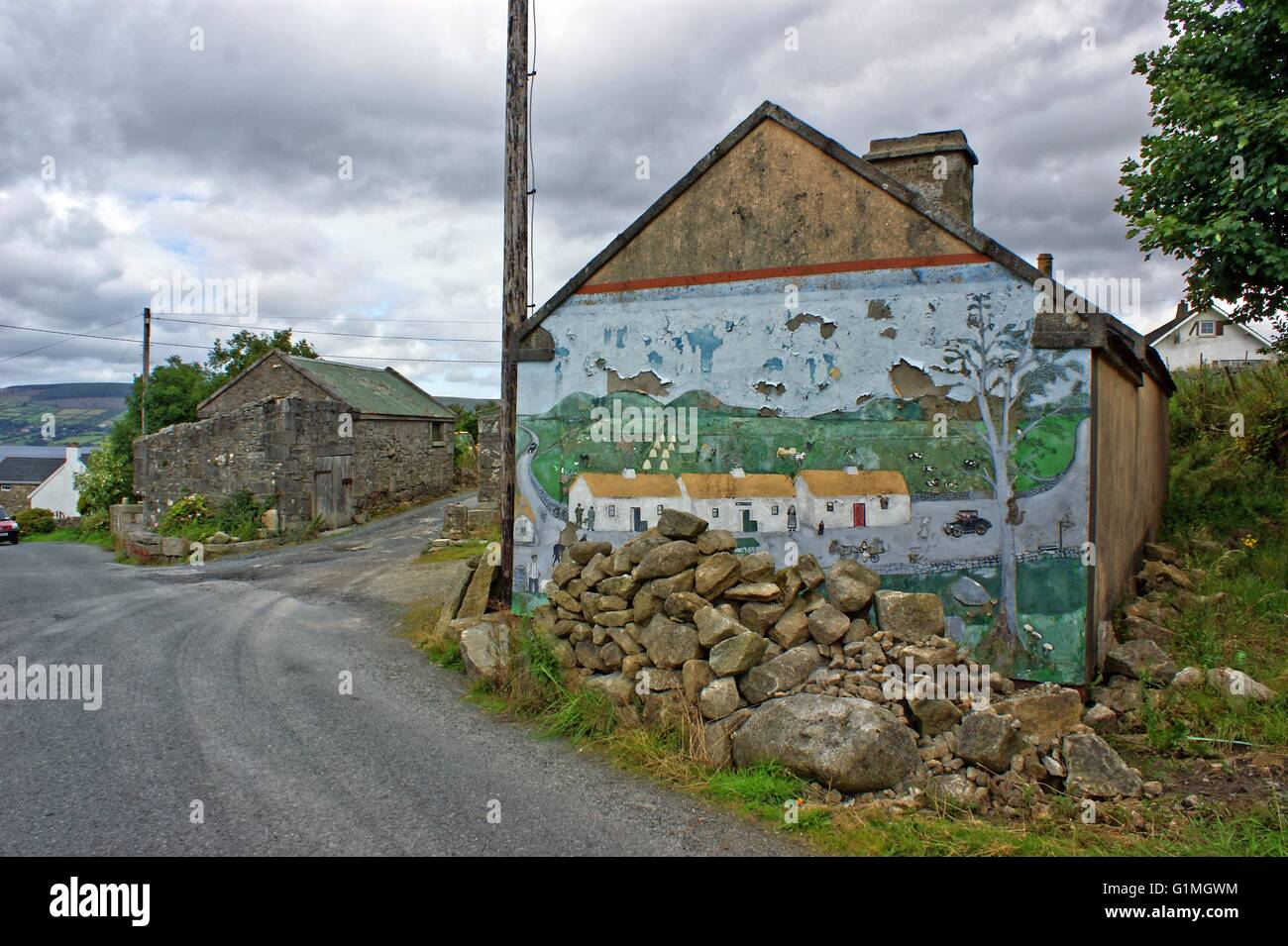 Old Painting Graffiti On A Stone Cottage In Ireland Showing Village Houses Front Rubble Of Stones Irish