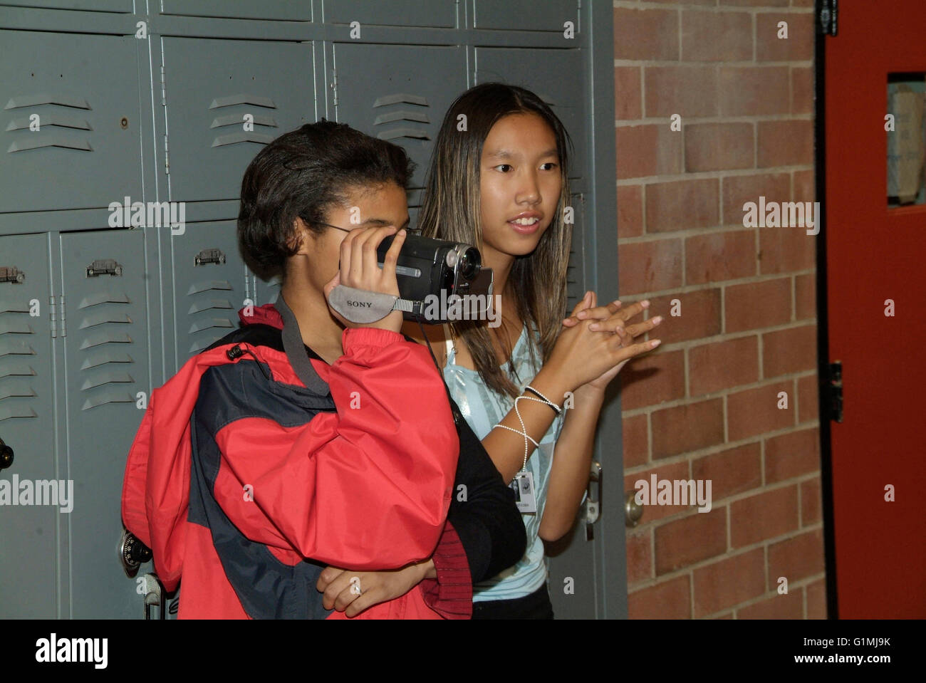 video teens Stock Photo - teens filming other students w video camera