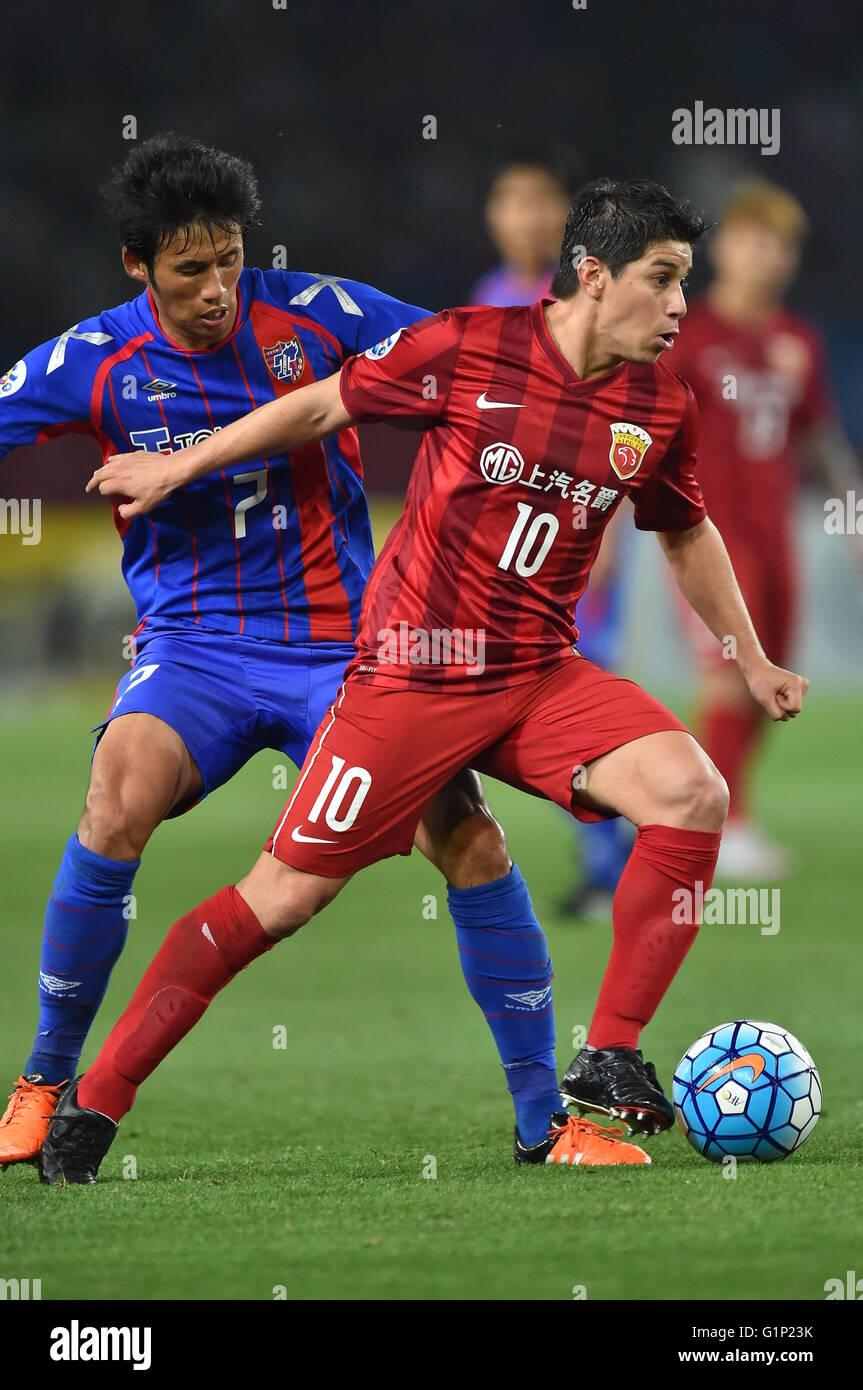 L R Takuji Yonemoto FC Tokyo Dario Conca SIPG MAY 17 2016