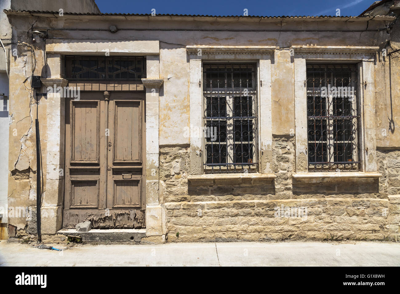 Wooden doors and windows with bars in the old building in old town ...
