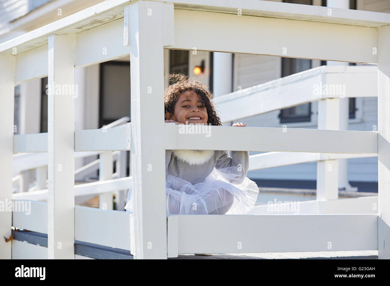 Kid Toddler Girl Playing Hiding Behind A Fence Outdoor Latin Ethnicity