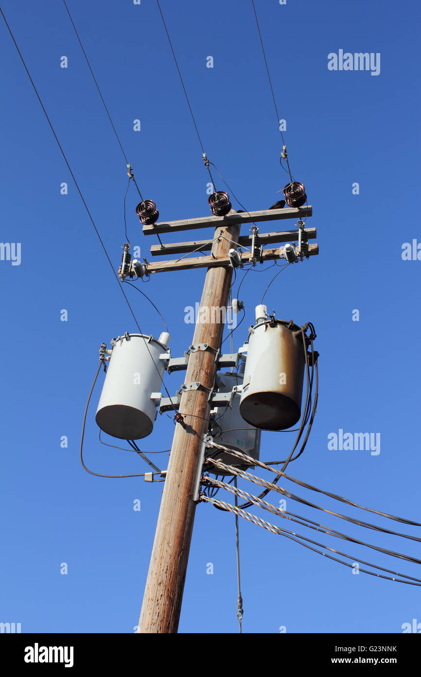 a distribution transformer mounted on a utility pole stock