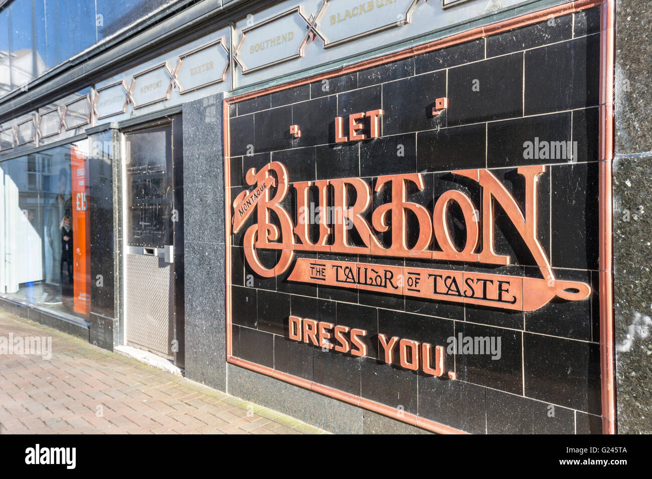 Old Burton tailor sign in tiles on side of shop, Abergavenny, Wales ...