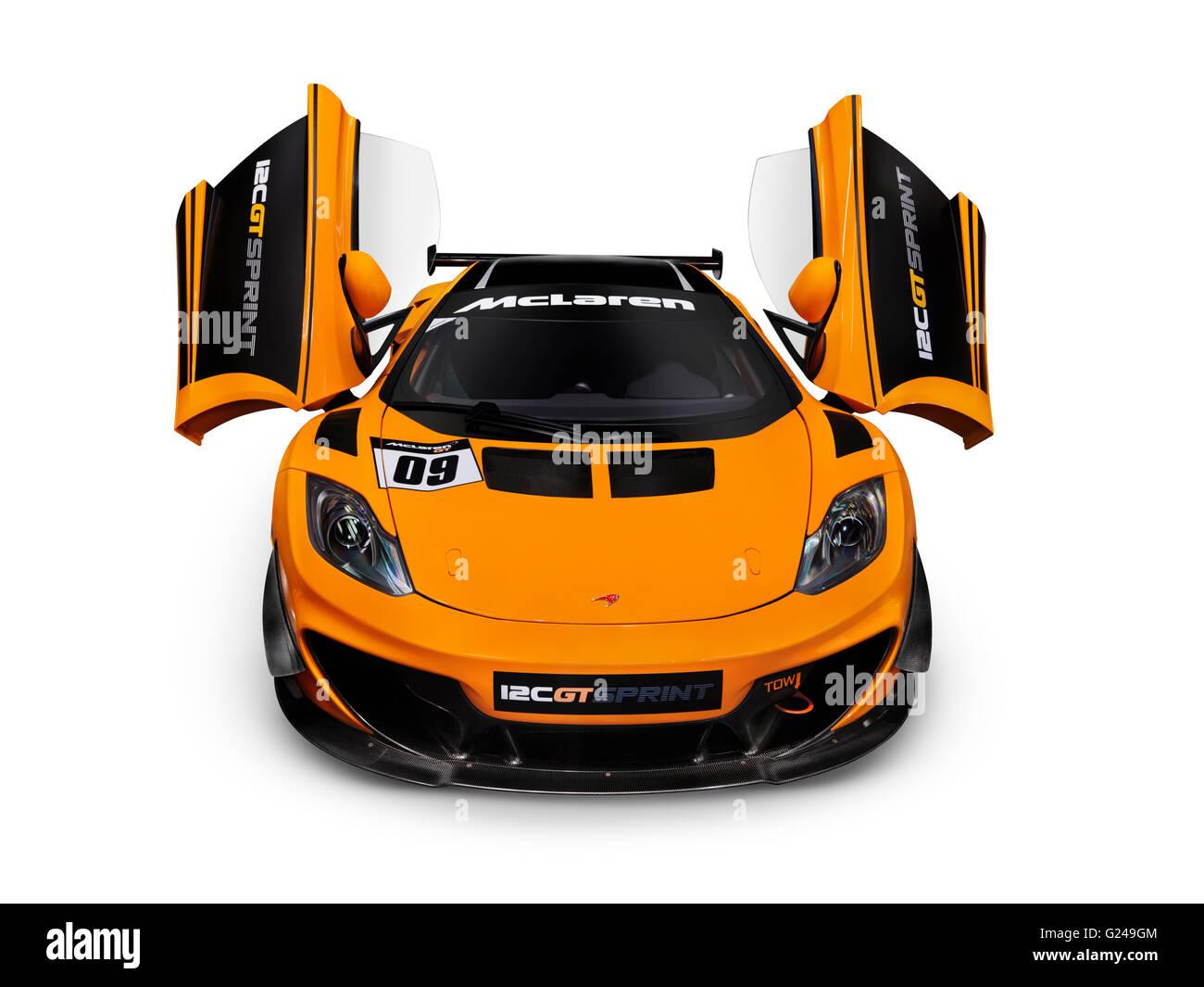 Orange 2014 McLaren 12C GT Sprint Supercar With Open Butterfly Doors    Stock Image