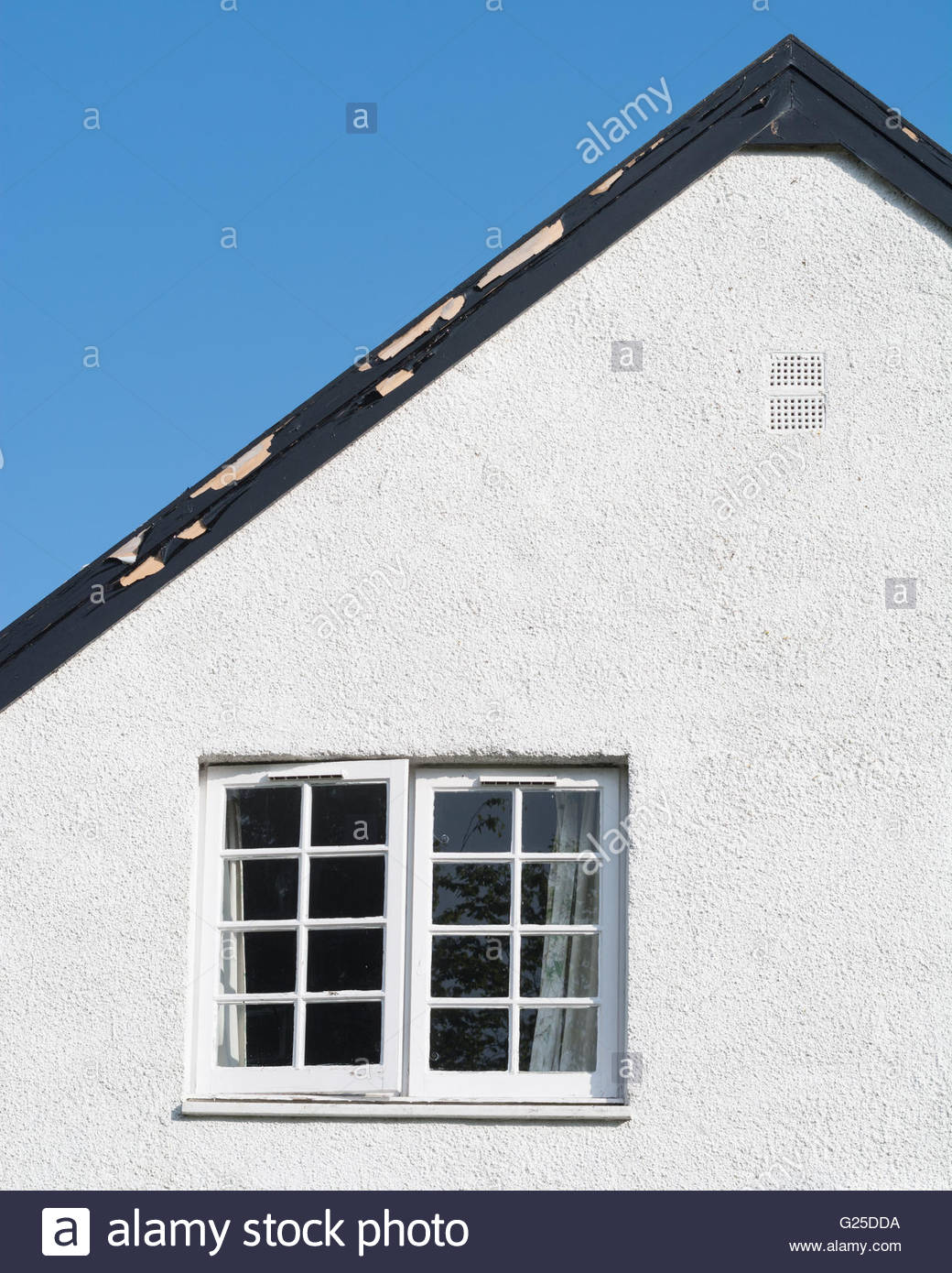 How to paint fascia boards - Stock Photo House Eaves In Need Of Painting With Flaking Paint On Wooden Fascia Board