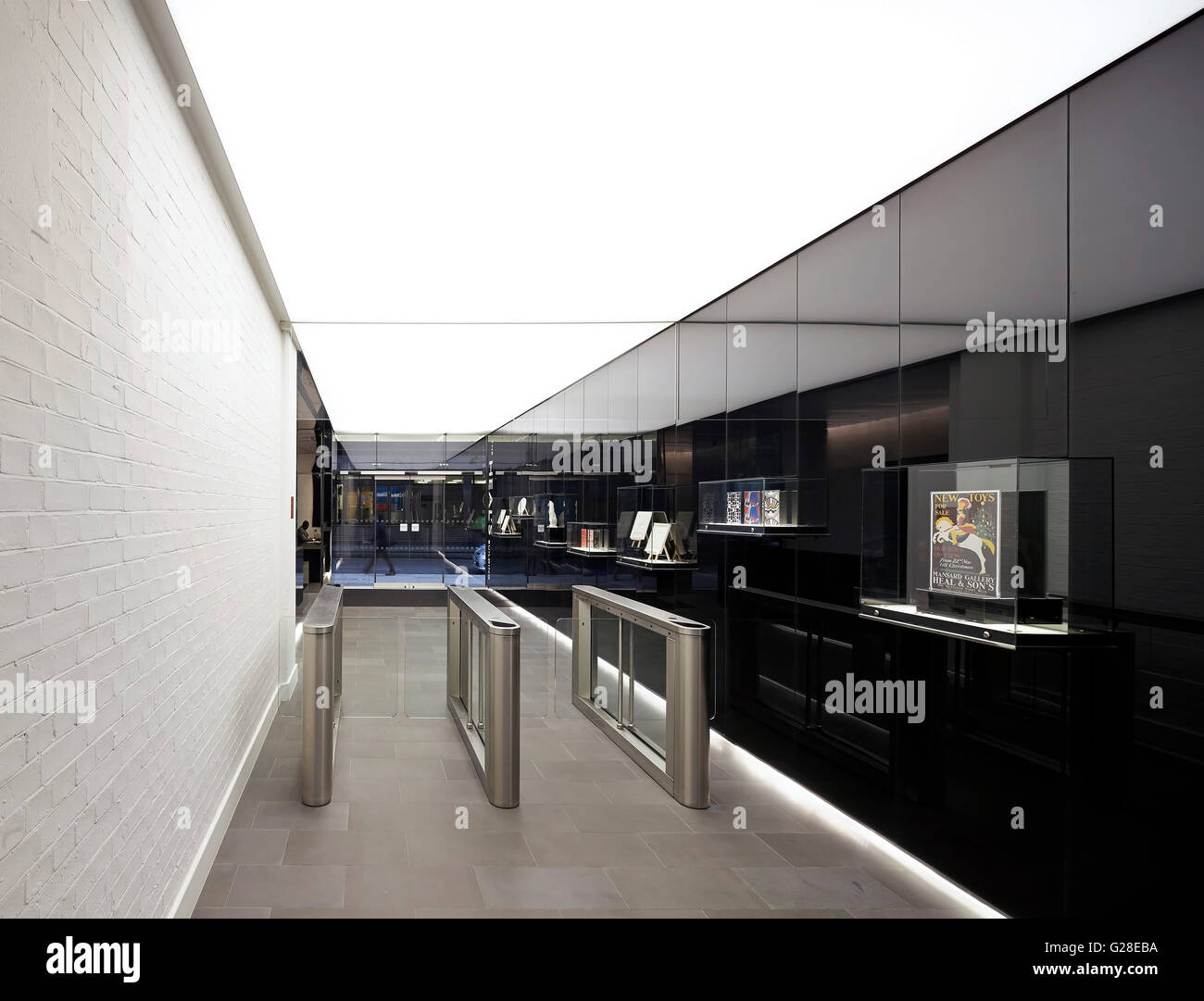 Entrance corridor with white brick wall and black polished panelling stock photo royalty free - Corridor entrance ...