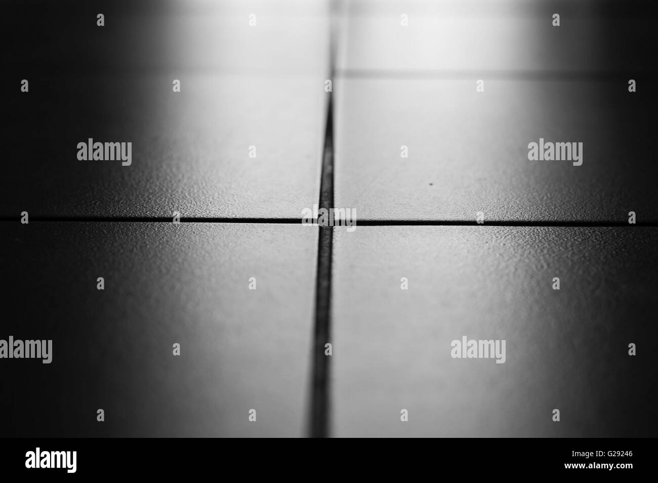 Tiles on the floor with backlight black and white photo stock tiles on the floor with backlight black and white photo dailygadgetfo Images