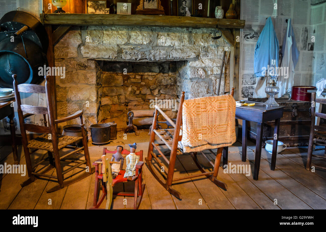 An Interior view of a rustically furnished log cabin with