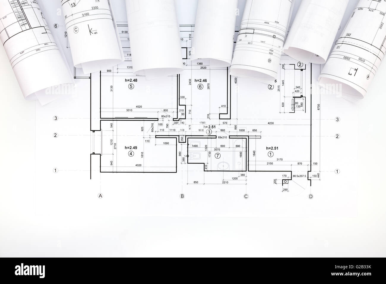 Architects workspace with rolled construction plans and blueprint architects workspace with rolled construction plans and blueprint malvernweather Image collections