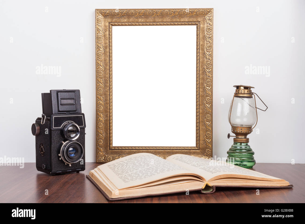 Old gold portrait frame with old camera and open book with lamp old gold portrait frame with old camera and open book with lamp jeuxipadfo Gallery
