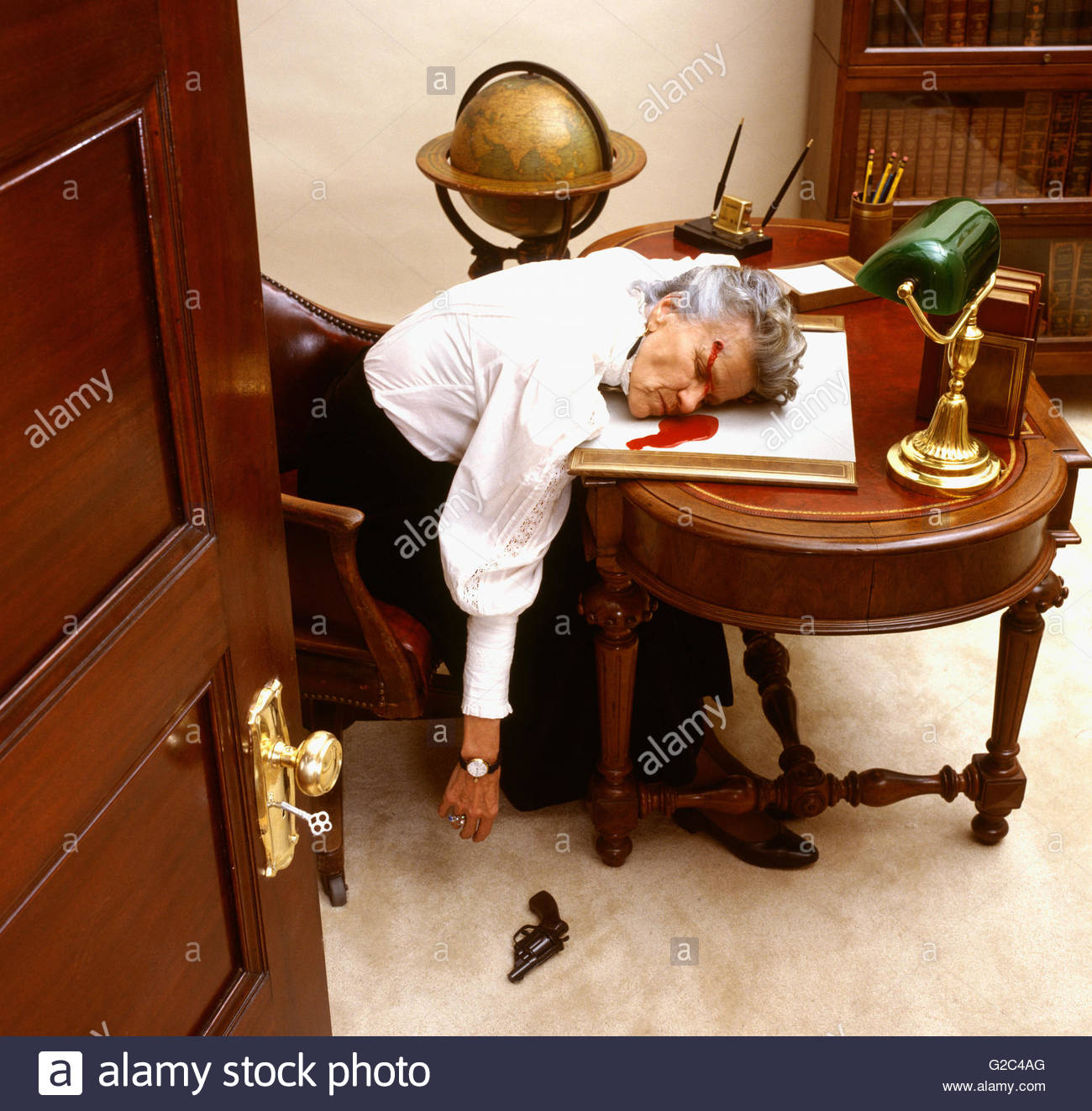 old lady committed suicide at work desk - Old Lady Committed Suicide At Work Desk Stock Photo, Royalty Free