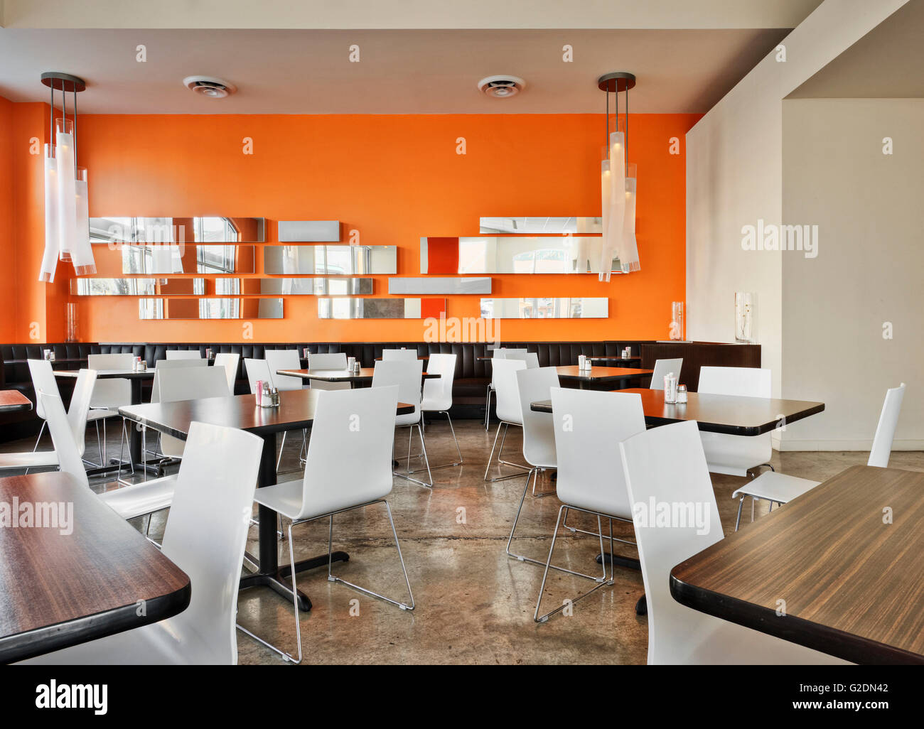 Modern Caf  with Orange Walls and White Chairs. Modern Caf  with Orange Walls and White Chairs Stock Photo