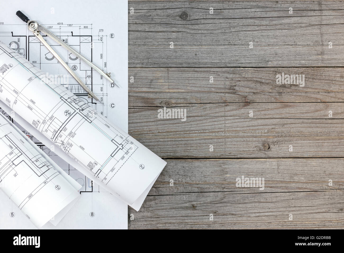 Architect Desk architect workspace with floor plan and drawing compass on gray