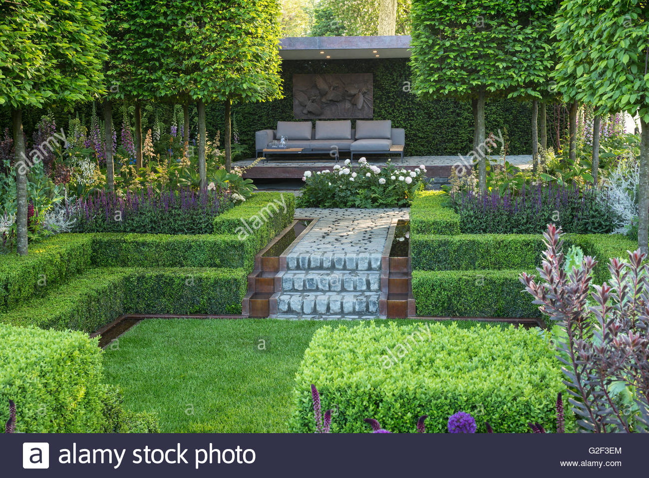 Stone paths box hedges and sunken lawn in Support The Husqvarna
