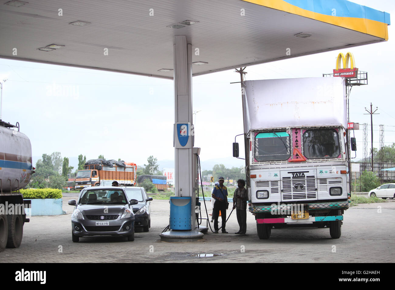 cars and trucks filling petrol and diesel at a gas station in india stock photo royalty free. Black Bedroom Furniture Sets. Home Design Ideas