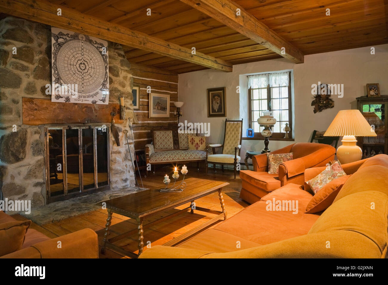 orange upholstered sofa chairs stone fireplace in living room