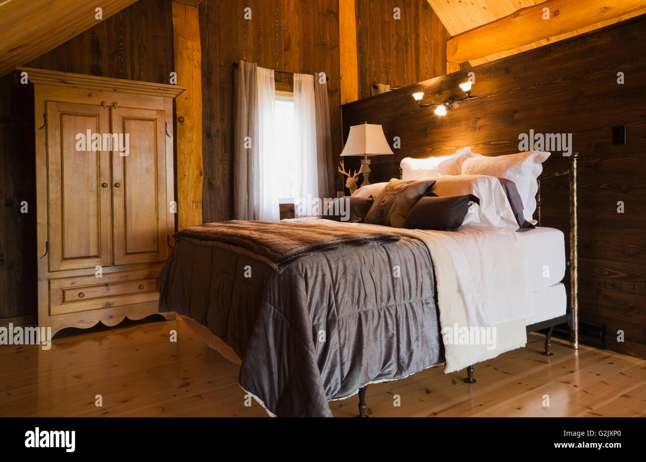 Quebec Bedroom Furniture Queen Size Bed Night Table On Mezzanine Inside A Luxurious Cottage