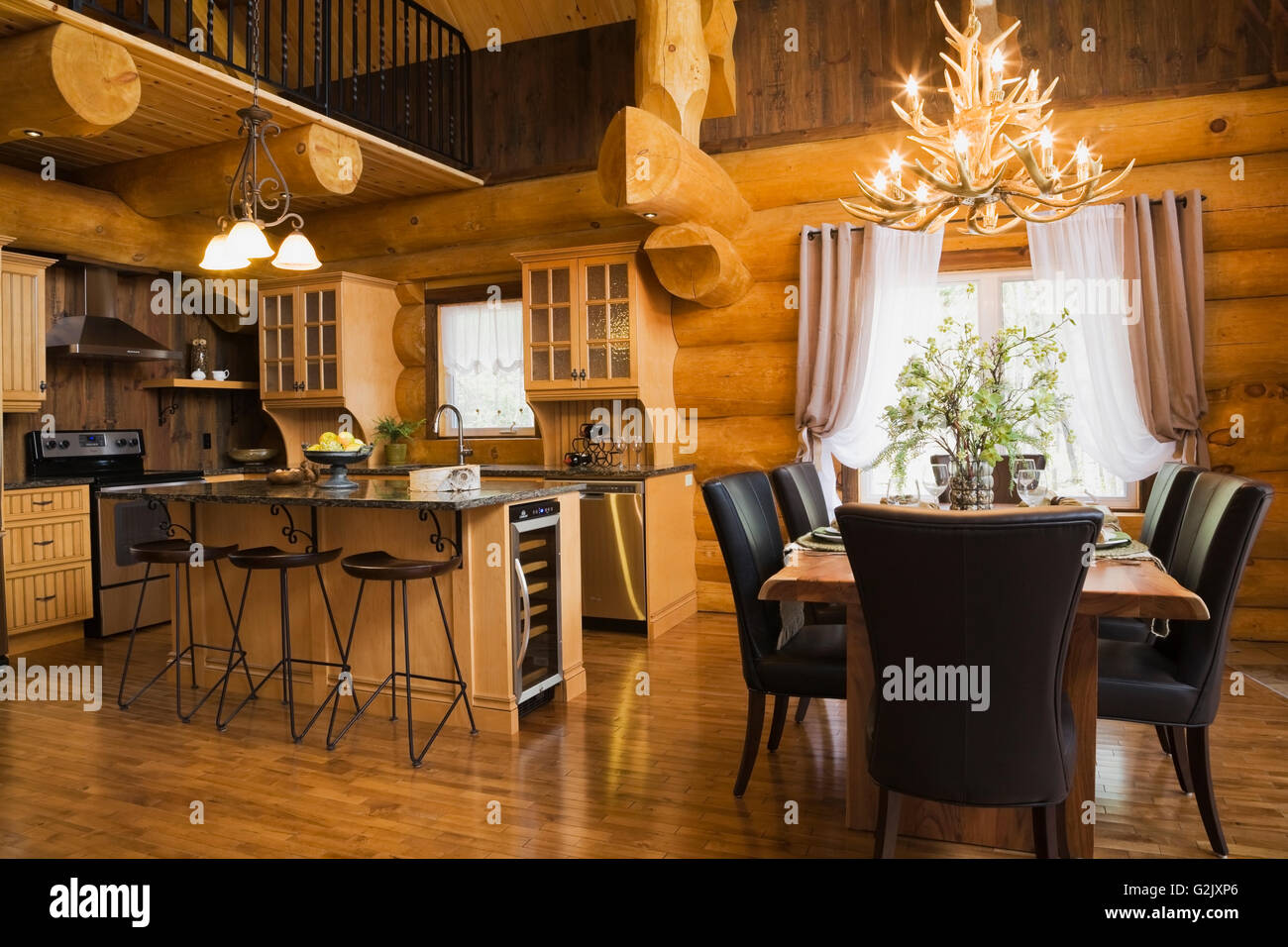 Kitchen Quartz Countertops Island Plus Natural Wood Dining Table Brown Leather Chairs In Room Inside A Luxurious Cottage