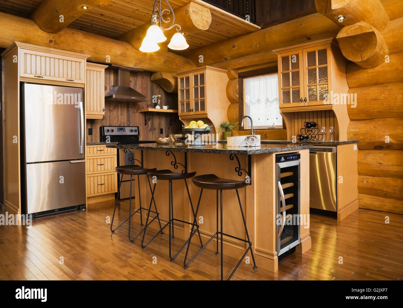 kitchen quartz countertops island bar stools inside a luxurious kitchen quartz countertops island bar stools inside a luxurious cottage style log home quebec canada this