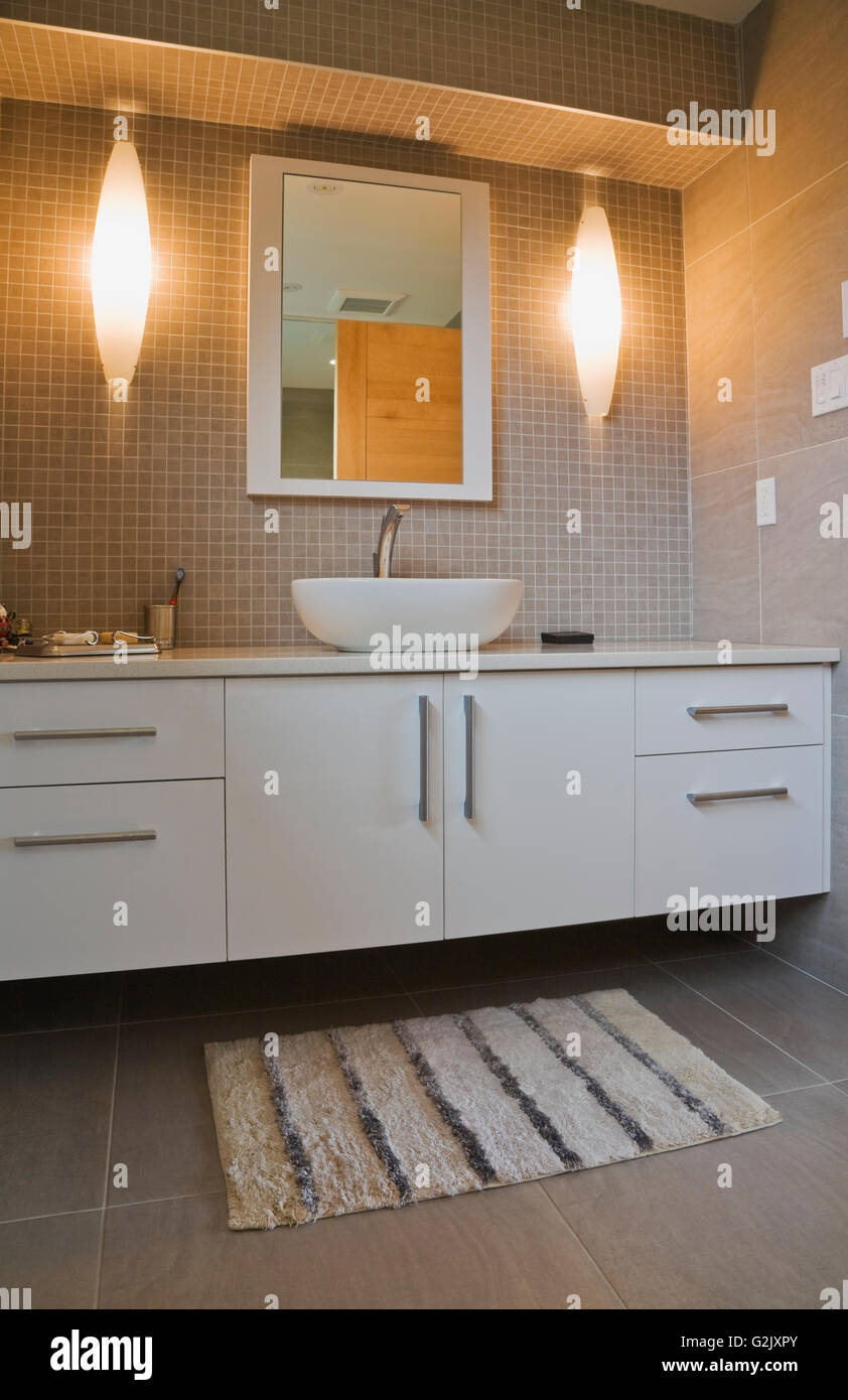 Superior Illuminated White Round Porcelain Sink Lacquered Vanity Mirror In A Guest  Bathroom On Upstairs Floor Inside A Modern Cubist