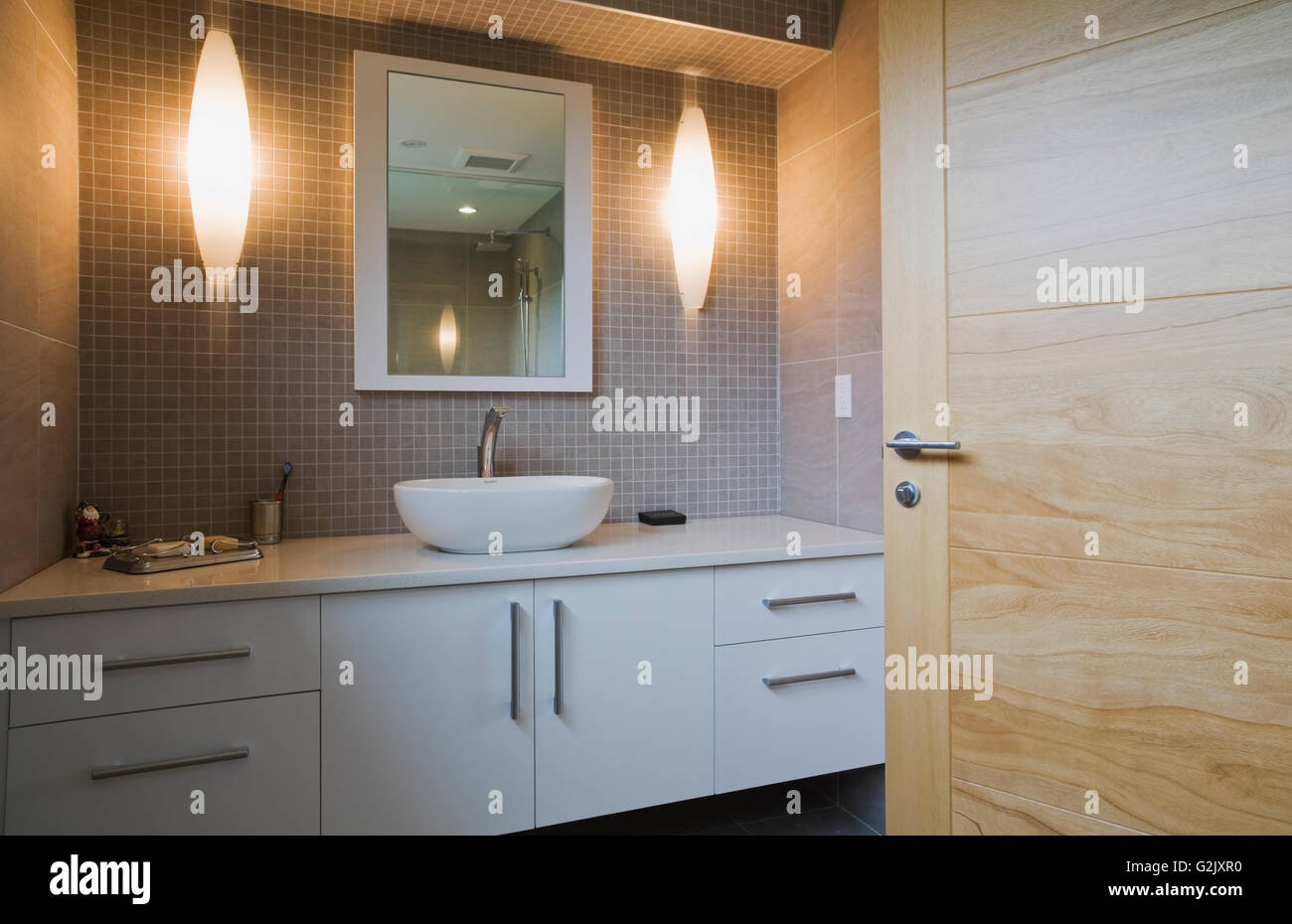 Illuminated White Round Porcelain Sink Lacquered Vanity Mirror In A Guest  Bathroom On Upstairs Floor Inside A Modern Cubist