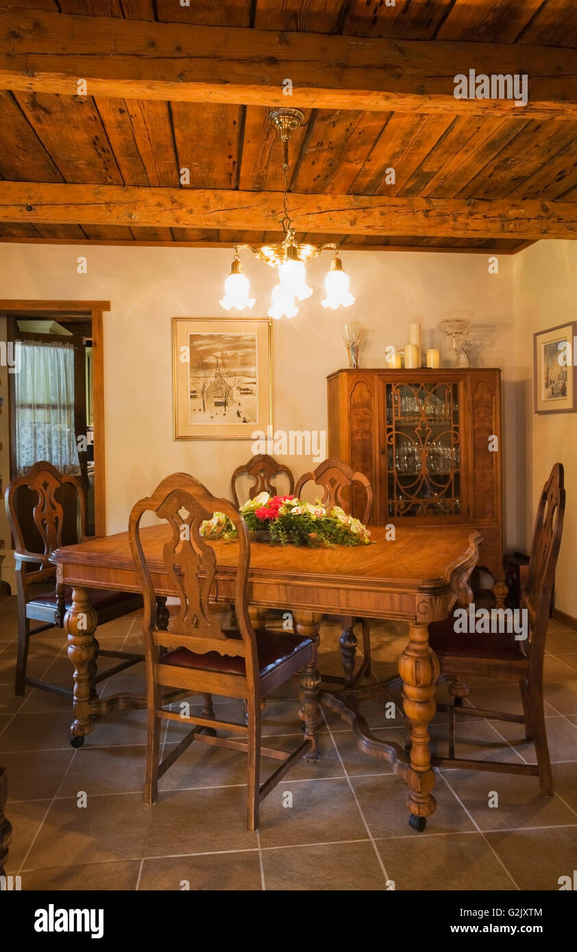 Old Wooden Dining Table Chairs In Room Inside A 1976 Reconstructed Cottage Style Log Home Quebec Canada This Image