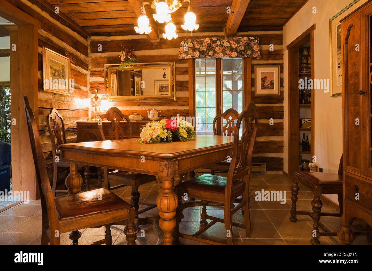 Old Wooden Dining Table Chairs In Dining Room Inside A 1976 Reconstructed  Cottage Style Log Home Quebec Canada This Image