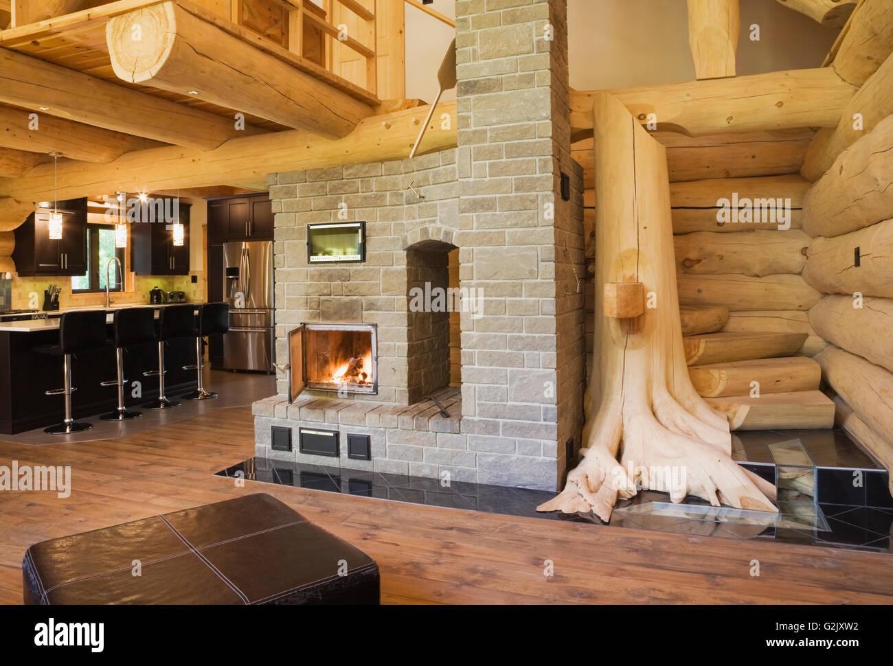 brown leather ottoman lit wood burning grey brick fireplace white