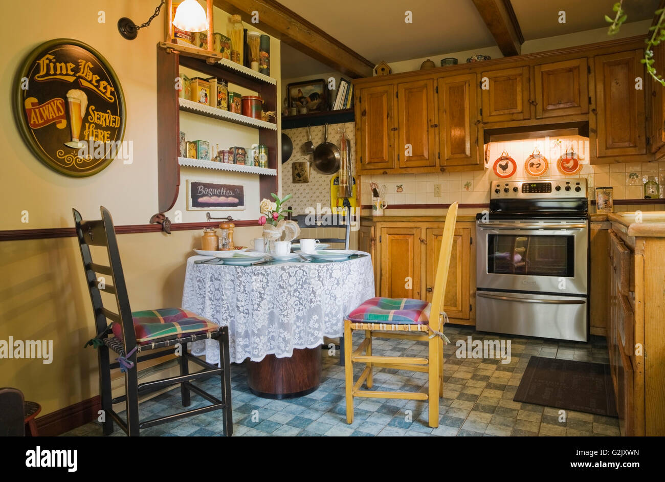 Wooden Antique Chairs Breakfast Table In Kitchen Inside Old Reconstructed 1850s Cottage Style Log Home Quebec Canada This Image