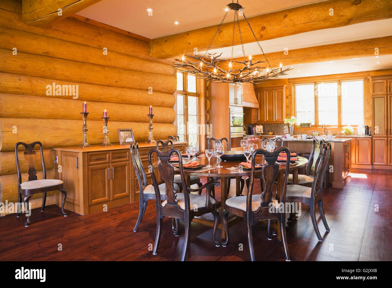 Round Wooden Dining Room Table 8 Chairs Kitchen Inside A Luxurious Cottage Style Log Home Quebec