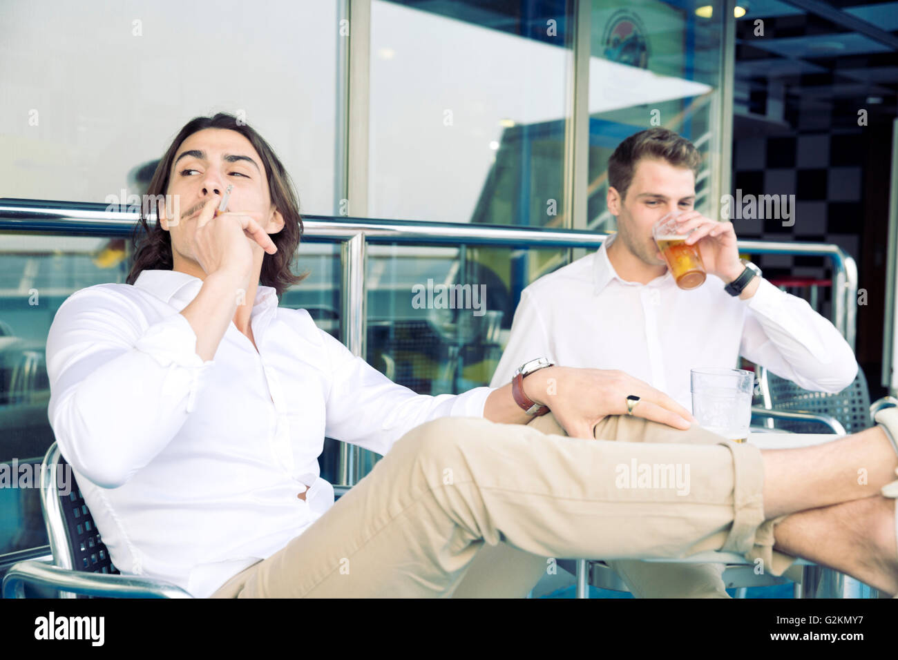 Two Young Men Smoking And Drinking Beer On Cruise Ship Stock Photo - Is there smoking on cruise ships