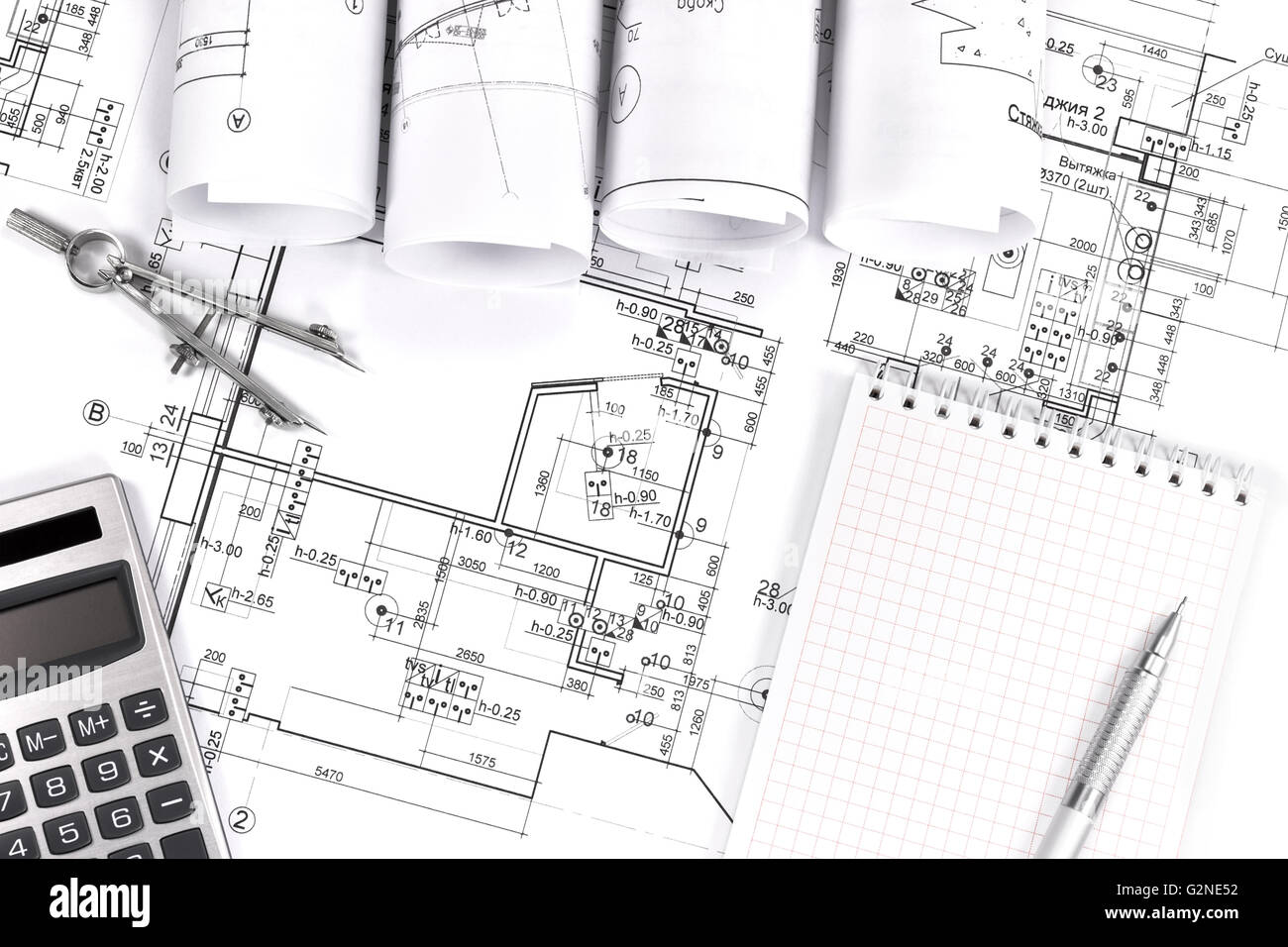 Rolls of architectural blueprints and brazil south america map rolls of architecture blueprints and house plans stock photo rolls of architecture blueprints and house plans malvernweather Images