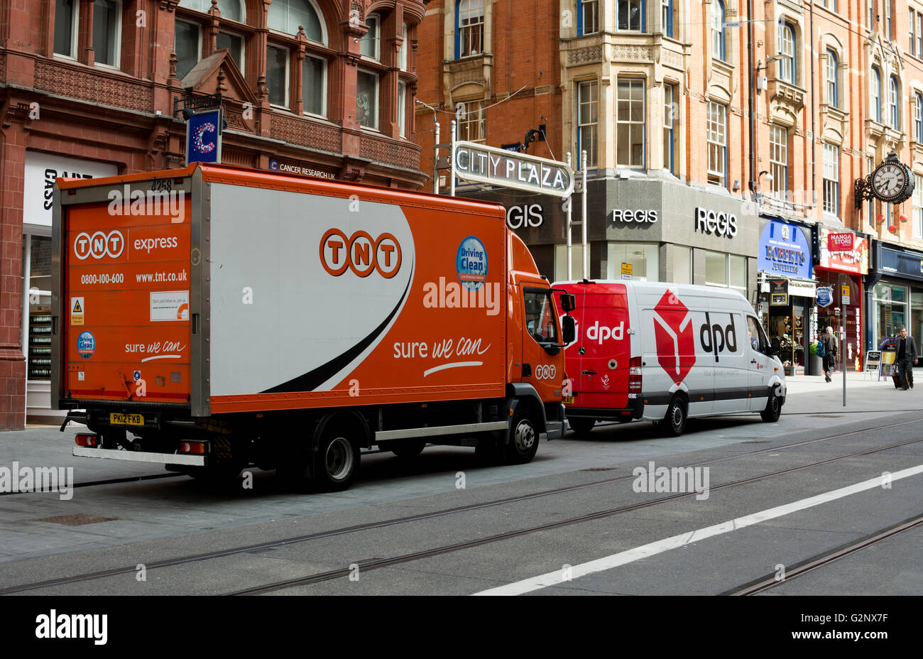 tnt and dpd parcel delivery vehicles birmingham city centre uk stock photo royalty free image. Black Bedroom Furniture Sets. Home Design Ideas