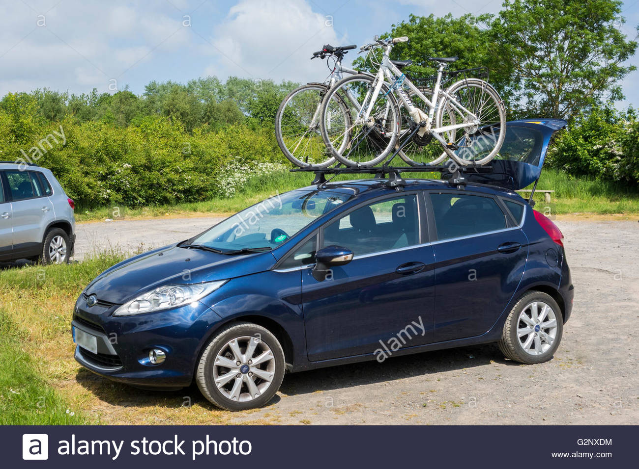 Ford Fiesta Roof Rack >> A Ford Fiesta car carrying two bikes on a roof rack Stock ...