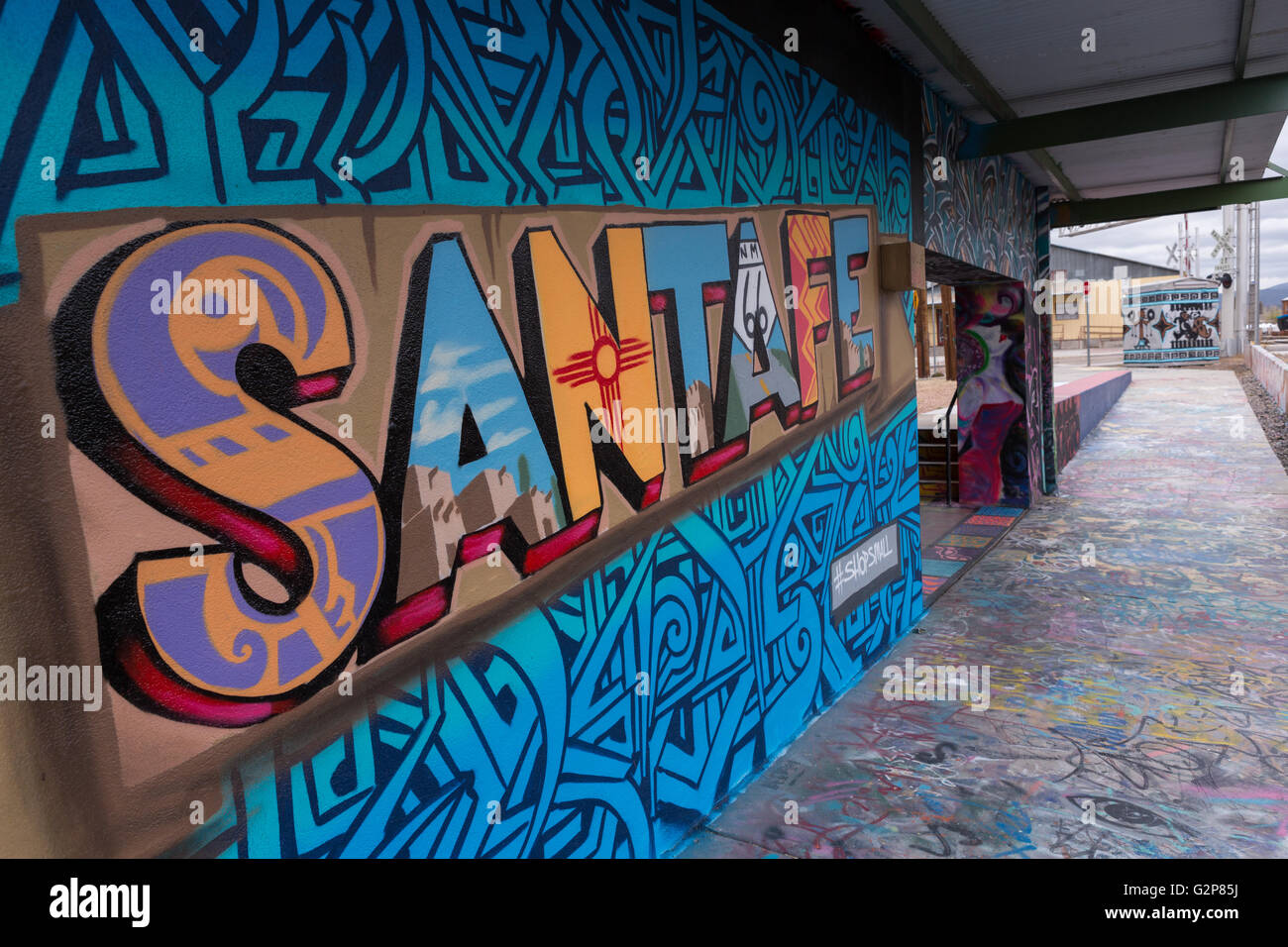 A Santa Fe Mural Painted Along The Wall Of Warehouse. Mubarak Banners. Staff Signs. Kubang Kerian Signs Of Stroke. Healed Signs. Cycle Route Signs Of Stroke. Small Bike Stickers. Heatstroke Prevention Signs. Triangle Signs Of Stroke