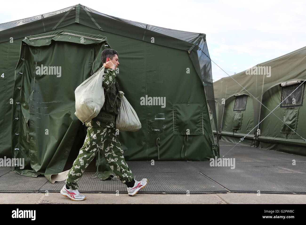 RYAZAN REGION RUSSIA - JUNE 2 2016 A participant in a tent c& during Operation Storm a project by the Russian Army Mayak Radio TV24 broadcaster and ... & RYAZAN REGION RUSSIA - JUNE 2 2016: A participant in a tent camp ...