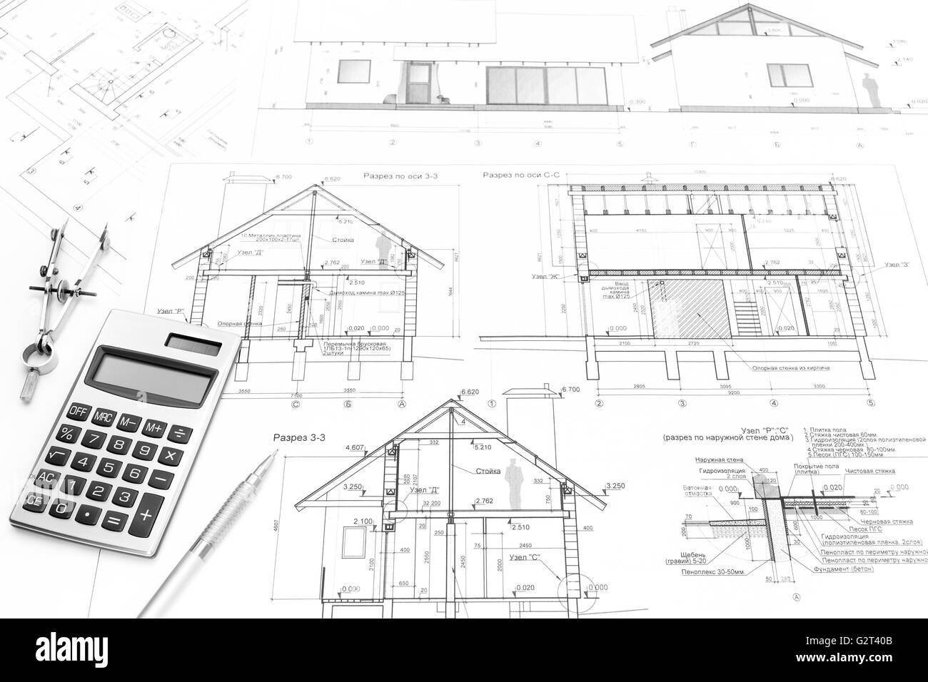 drawing compass calculator pencil and architectural drawings of modern house