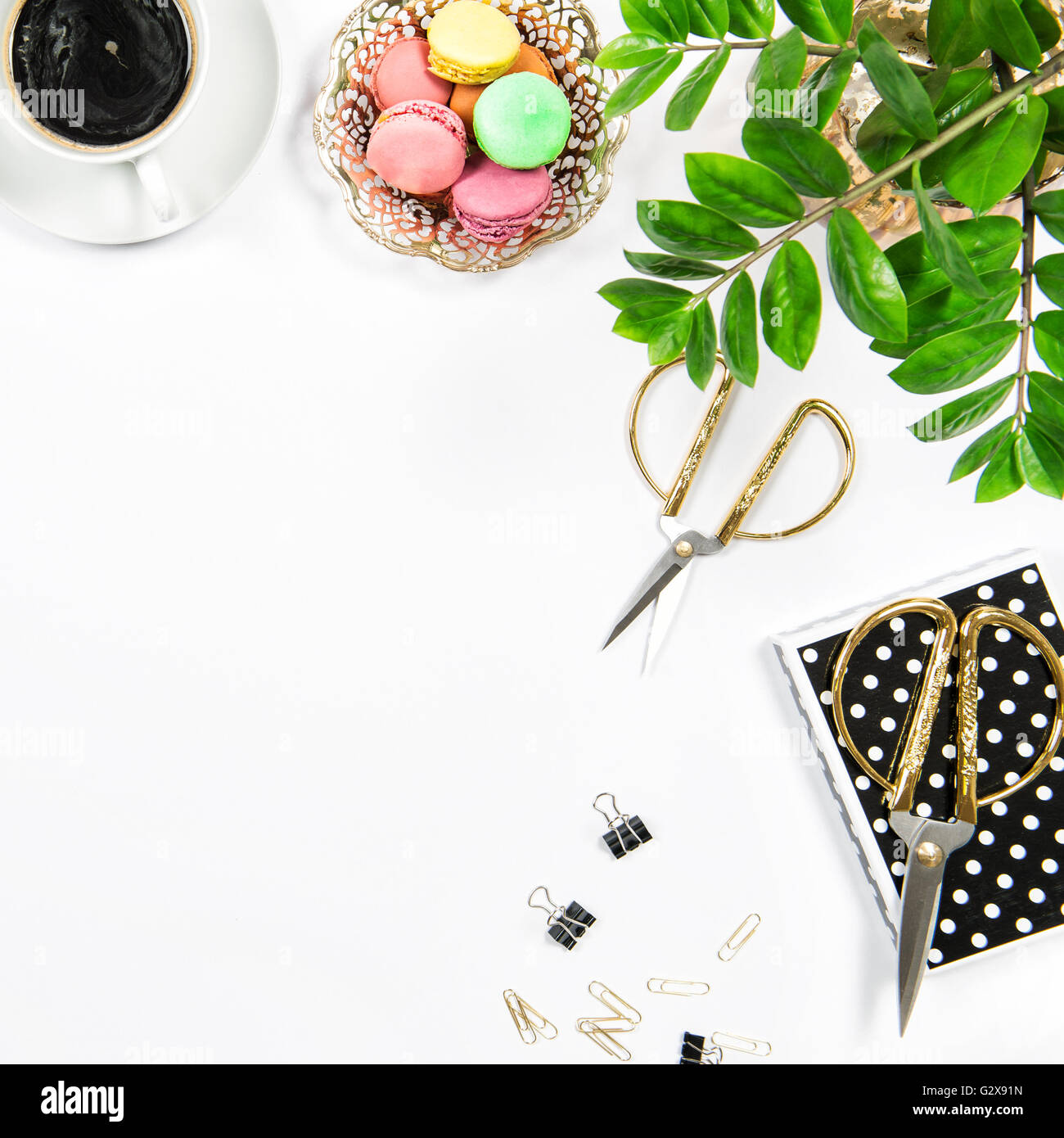 Feminine Workplace With Coffee, Macarons Cookies, Office Supplies And Green  Plant On White Table Background. Flat Lay