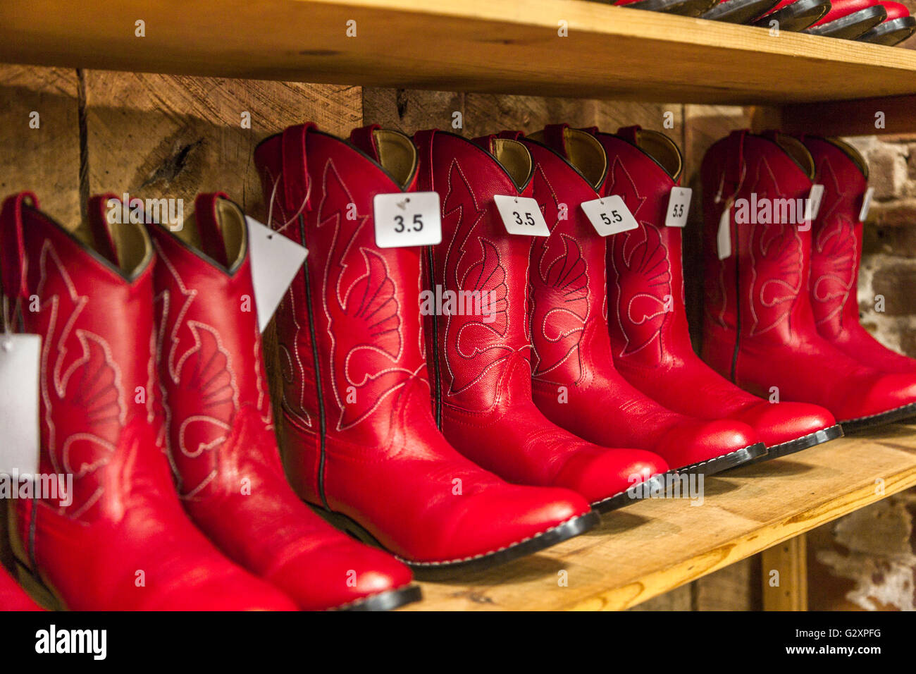 Women's red cowboy boots for sale at boot store in downtown Stock ...