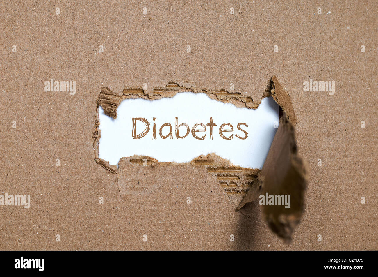 the word diabetes appearing behind torn paper stock photo royalty stock photo the word diabetes appearing behind torn paper