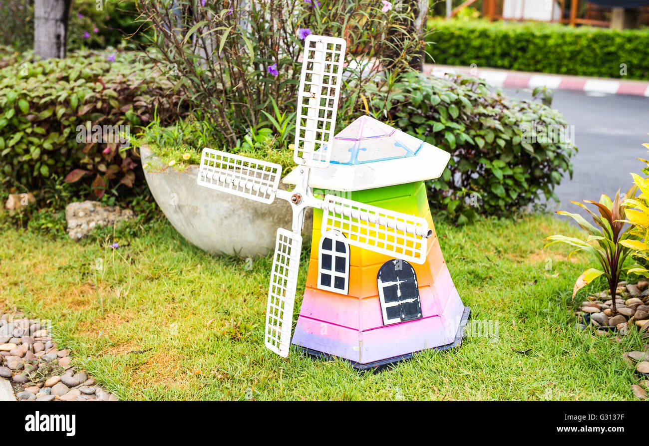 Decorative Wooden Windmill In The Garden. Carving Art. Architectural  Element.
