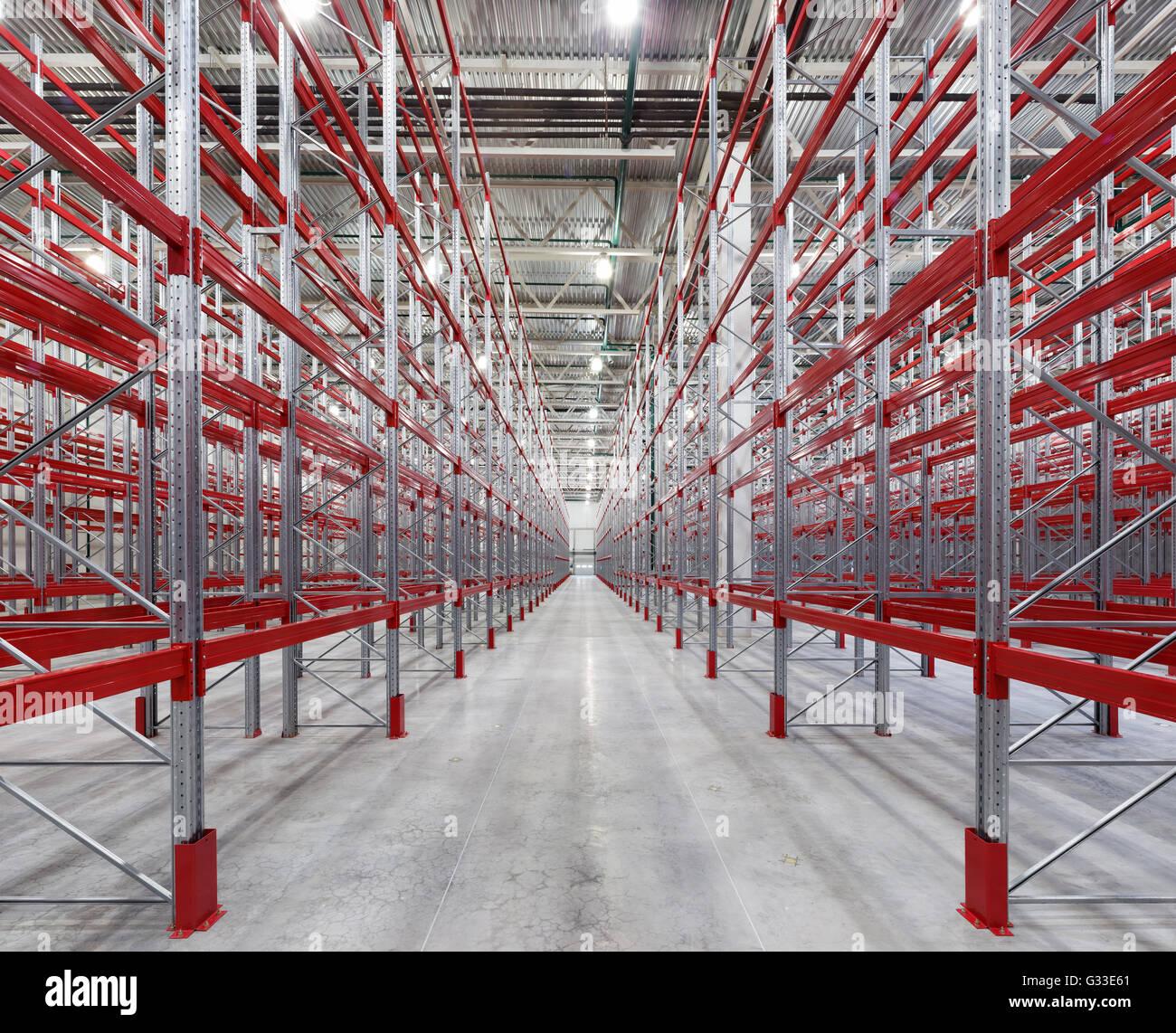 Industrial Racks Pallets Shelves In Huge Empty Warehouse