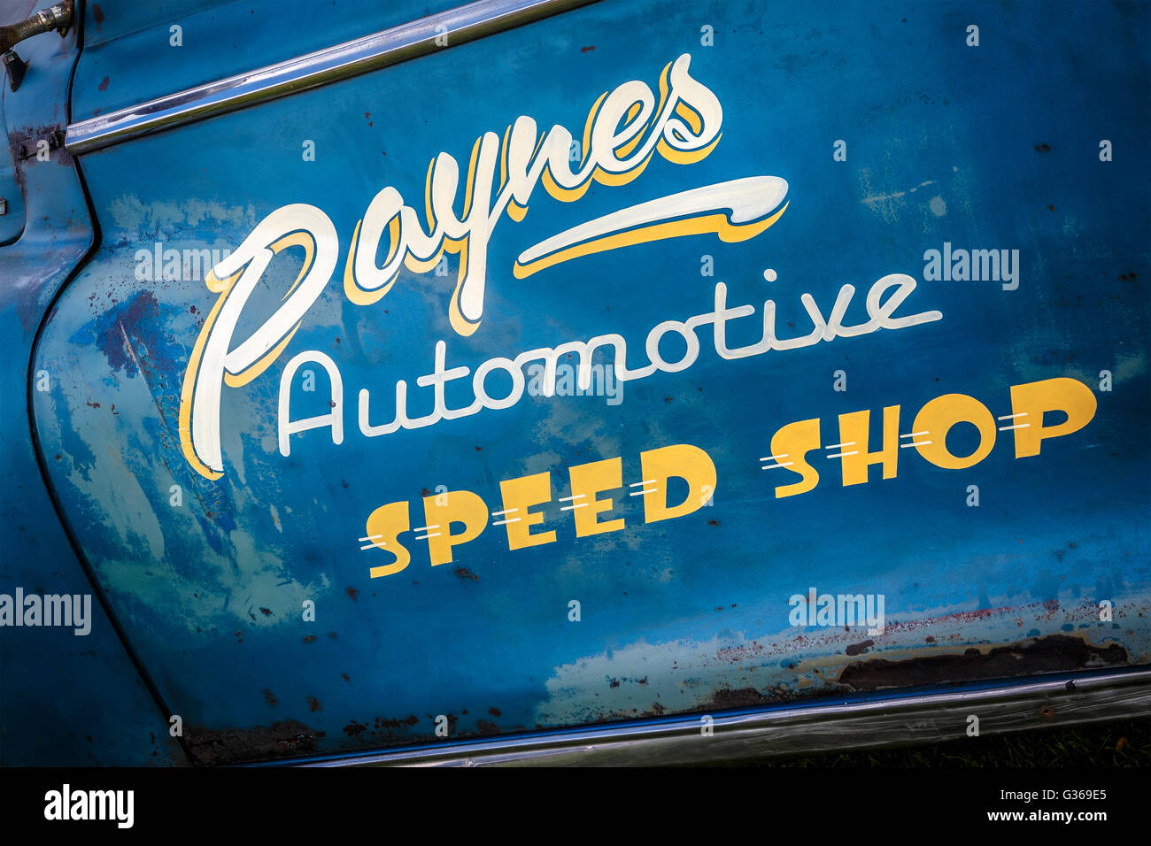 Paynes Automotive Speed Shop Sign Writing On The Door Of A - Chrysler shop