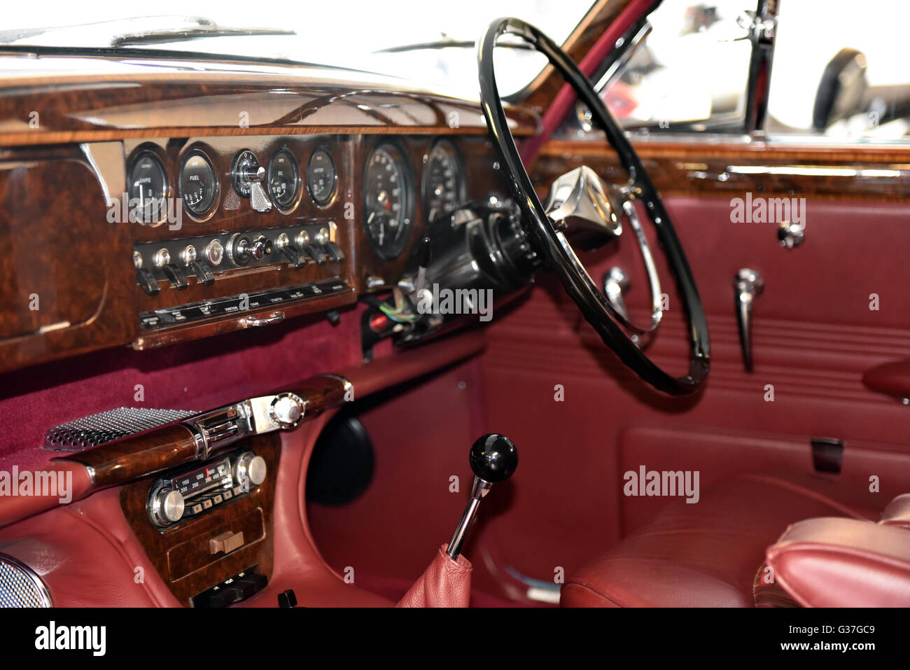 interior dashboard of a classic jaguar s type with walnut and red stock photo royalty free. Black Bedroom Furniture Sets. Home Design Ideas